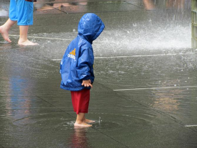 Boy playing in the fountain at Millennium Park, Chicago, IL  Summer, 2011.