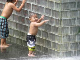 Boy playing in the fountain, Millennium Park, Chicago, IL Summer, 2011.