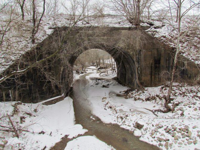 A portal to a winter wonderland, under the train tracks.  Near Seigel, IL February 2013.